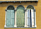 A watercolour painting of shuttered windows in Venice by Margaret Heath RSMA.